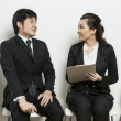 Chinese business woman interviewing male applicant. — Stock Photo