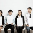Chinese Business team hold up blank cards. — Stock Photo #16895761