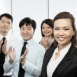 Chinese business team clapping. — Stock Photo