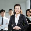 Chinese Business woman with her team. — Stock Photo #16895853
