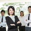 Chinese Business woman with her team. — Stock Photo #16895863