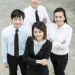 Chinese Business woman with her team. — Stock Photo #16895865