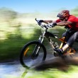 Mriding mountain bike — Stock Photo #16896419