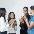 Indian business women clapping — Stock Photo