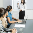 Stock Photo: Indian business woman doing a presentation.