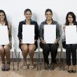 Stock Photo: Indian judges hold up blank cards.