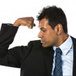 Indian business man flexing his arm. — Stock Photo