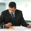 Indian business man working with touch pad, PC. — Stock Photo #16896973