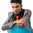 Indian businessman leaning chair. — Stock Photo