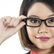 Close-up of young Chinese Woman wearing glasses — Stock Photo #16898181