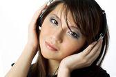 Chinese Woman listening earphones — Stock Photo