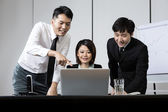 Chinese business team working together — Foto de Stock