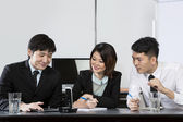 Chinese Business team in conference call — Stock Photo