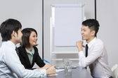 Chinese Business team having a meeting. — Stock Photo
