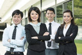 Chinese Business woman with her team. — Stock Photo