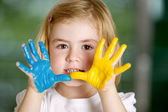 Little girl with hands painted — Foto de Stock