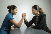 Business women fighting for control. — Stock Photo