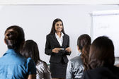 Indian businesswoman giving a lecture — Stock Photo