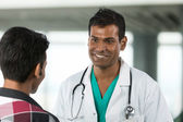 Indian Doctor talking a patient. — Photo