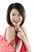 Chinese woman holding shopping bags. — Stock Photo