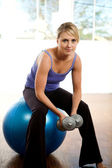 Fit and sporty girl exercising. — Stock Photo