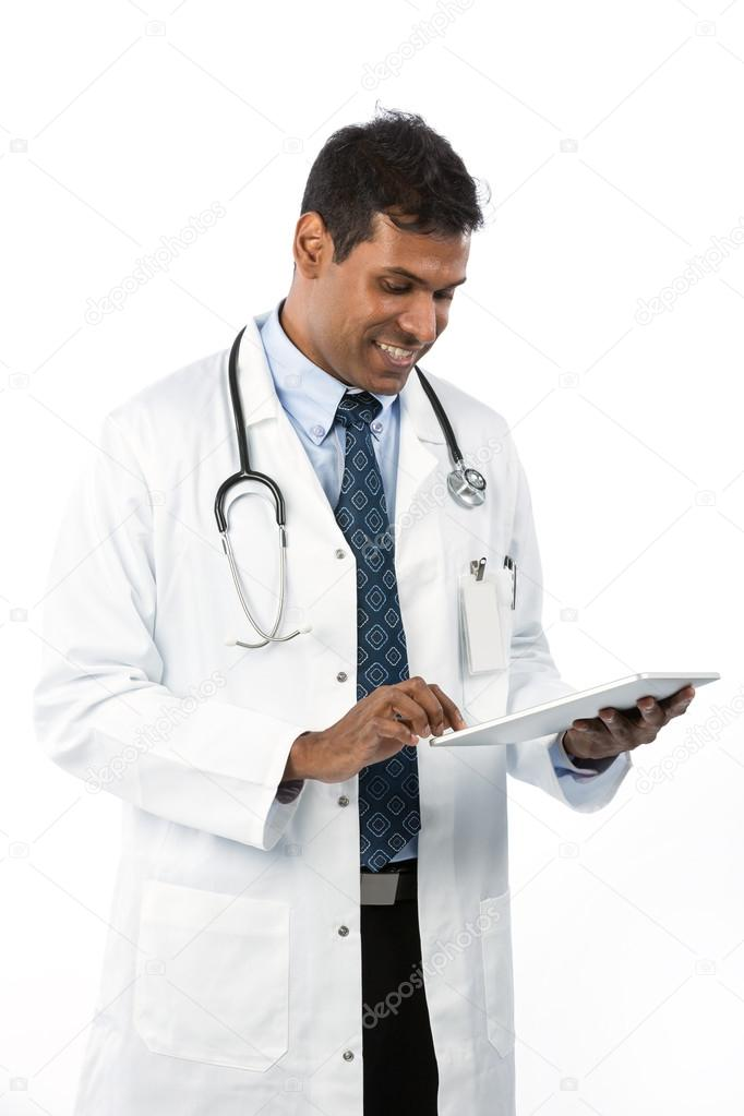 Male Asian doctor holding a digital tablet & wearing a lab coat plus stethoscope. — Стоковая фотография #16897085