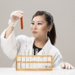 Chinese Female scientist handling chemicals — Stock Photo #26990627