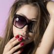 Beautiful fashion model wearing sunglasses  — Stock Photo