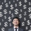 Businessman with signs of Finance — Stock Photo