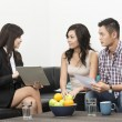 Finance Consultant showing investment plans to Asian couple — Stockfoto
