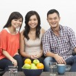 Happy Chinese friends hanging out together at home — Stock Photo
