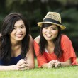Two Chinese female friends having fun outdoors — Stock Photo