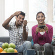 Indian Couple Having Fun Playing Video Console Game — Stock Photo #27025577