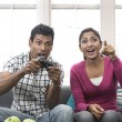 Indian Couple Having Fun Playing Video Console Game — Stock Photo
