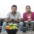 Indian couple on the sofa watching tv — Stock Photo
