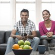 Happy Indian couple on the sofa — Stock Photo