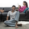Indian couple on the sofa watching tv — Stock Photo #27025749