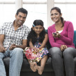 Parents and child relaxing at home on sofa. — Foto Stock