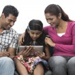 Happy Indian family at home using digital tablet — Stock Photo