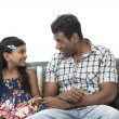 Foto Stock: Happy Indian dad and his child at home