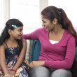 Young Indian mum and daughter at home — Stock Photo