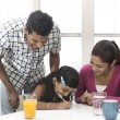 Indian family helping their child with her study work — Foto Stock