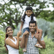 Happy Indian family at the park. — Stock Photo #27026115
