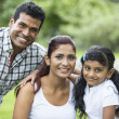 Happy Indian family at the park. — Foto Stock