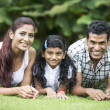 Happy Indian family at the park. — Stock Photo