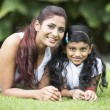 Happy Indian mum and her child playing outdoors — Stock Photo
