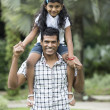 Happy Indian dad and his child playing outdoors — Stock Photo