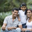 Stock Photo: Happy Indifamily at park.