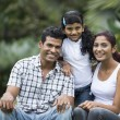 Happy Indian family at the park. — Stock Photo #27026189