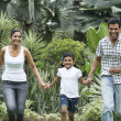 Happy indian family running together outdoors — Stock Photo